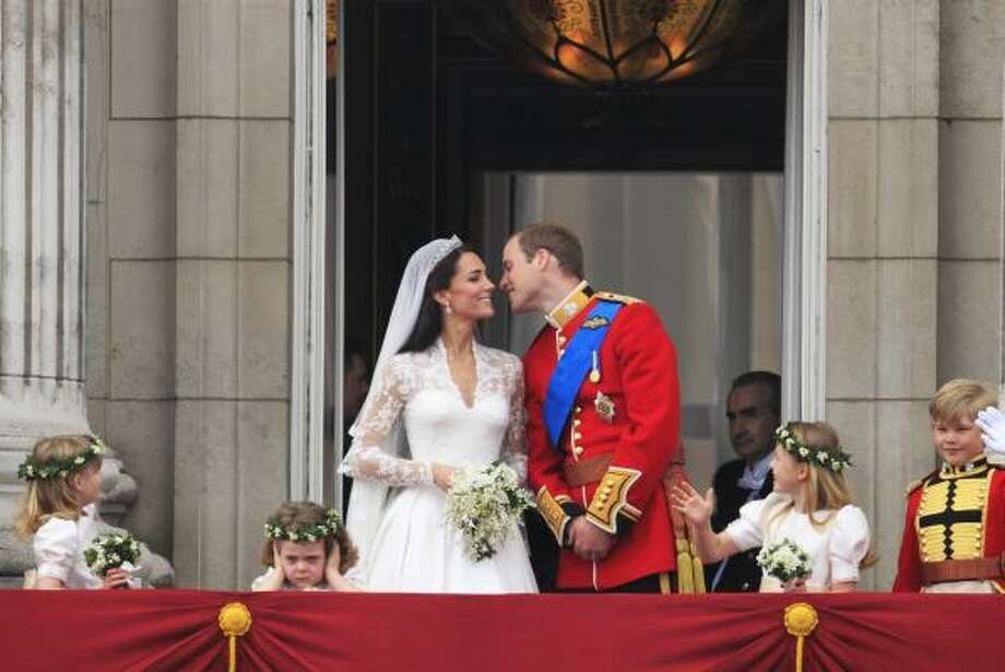 Britain's Prince William kisses his wife Kate, Duchess of Cambridge on from the balcony of Buckingham Palace after the Royal Wedding in London Friday, April, 29, 2011. Photo: Matt Dunham, AP