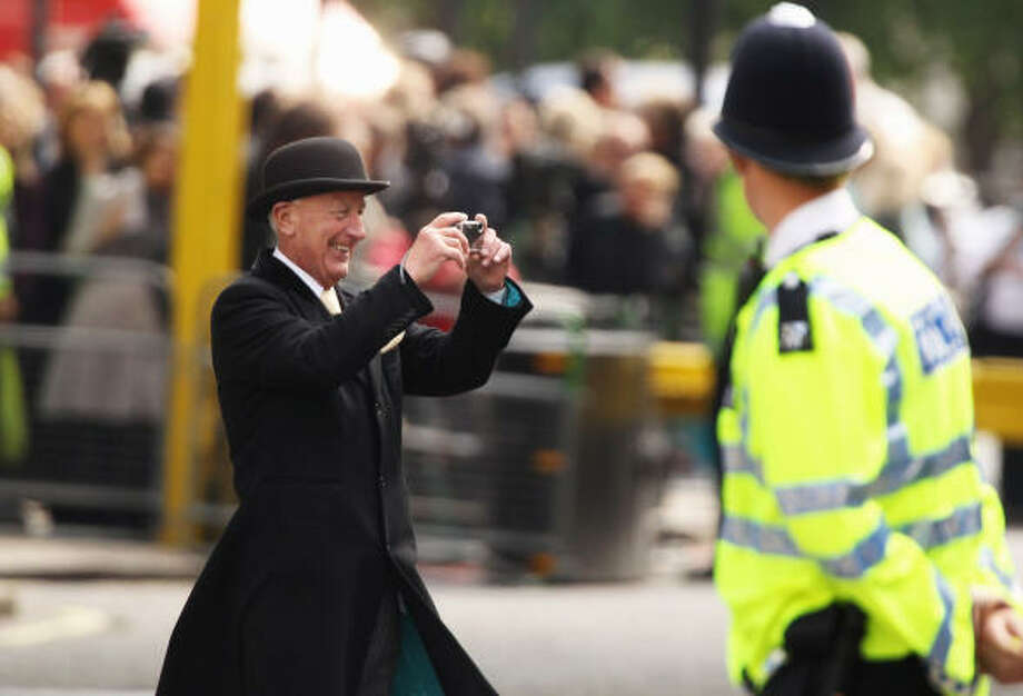 A Goring Hotel staff member tries to capture all the excitement. Photo: Jeff J Mitchell, Getty Images