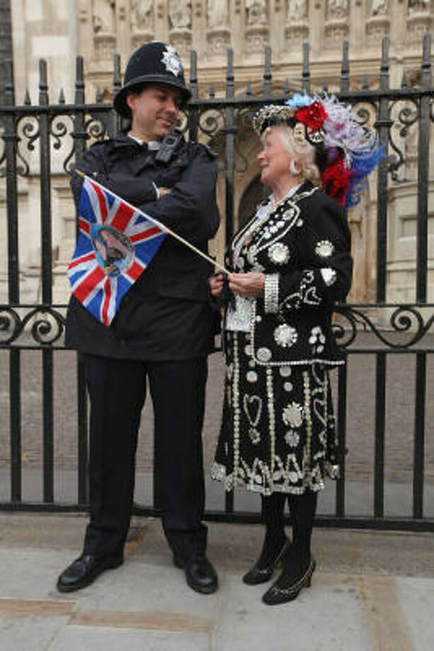 A fan of the royal family chats with a policeman outside Westminster Abbey, the site of the wedding. Photo: Sean Gallup, Getty Images
