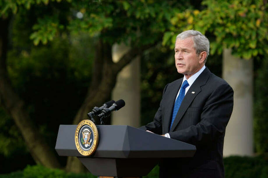 President Bush outlines the government plan during a statement this morning in the Rose Garden of the White House. Photo: Alex Wong, Getty Images