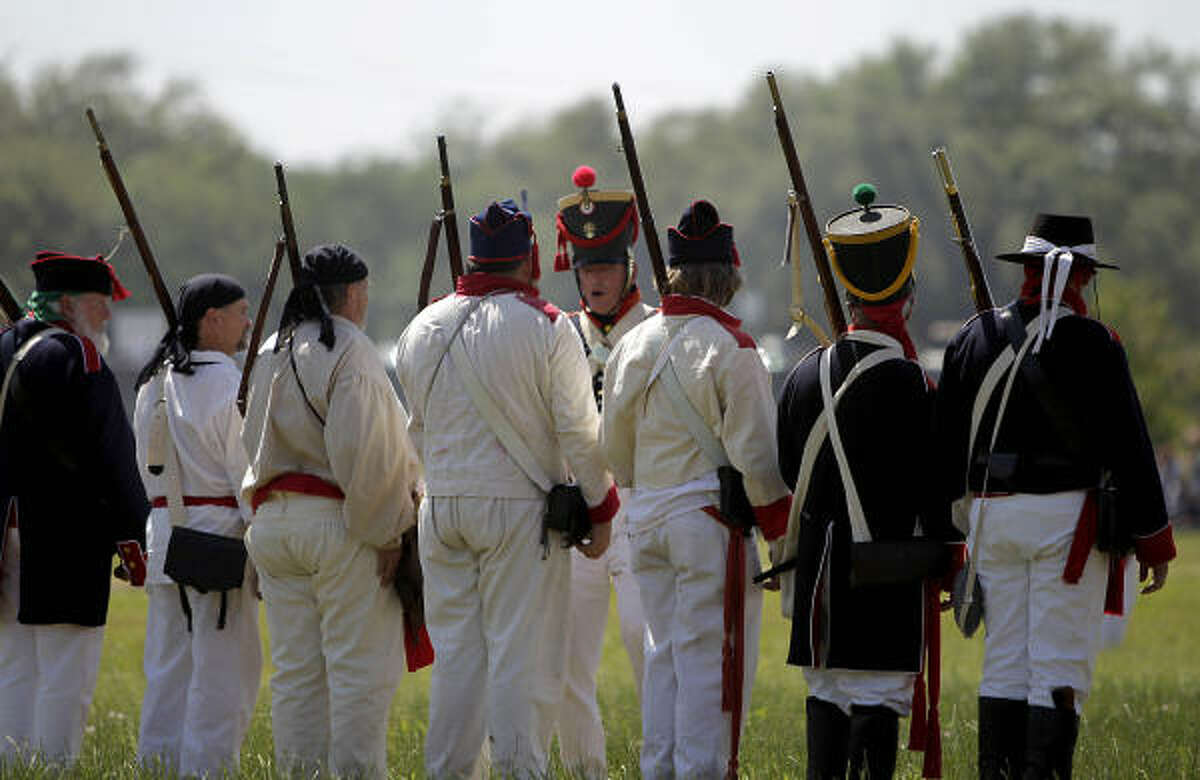 Re-enactors simulate events the day before the Battle of San Jacinto on the grounds of the San Jacinto Battleground.