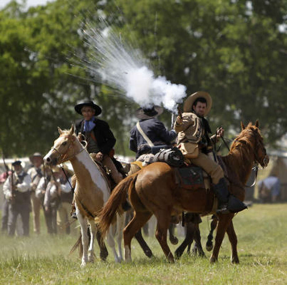 Re-enactors clash on horses simulating events the day before the Battle of San Jacinto. Photo: Karen Warren, Houston Chronicle
