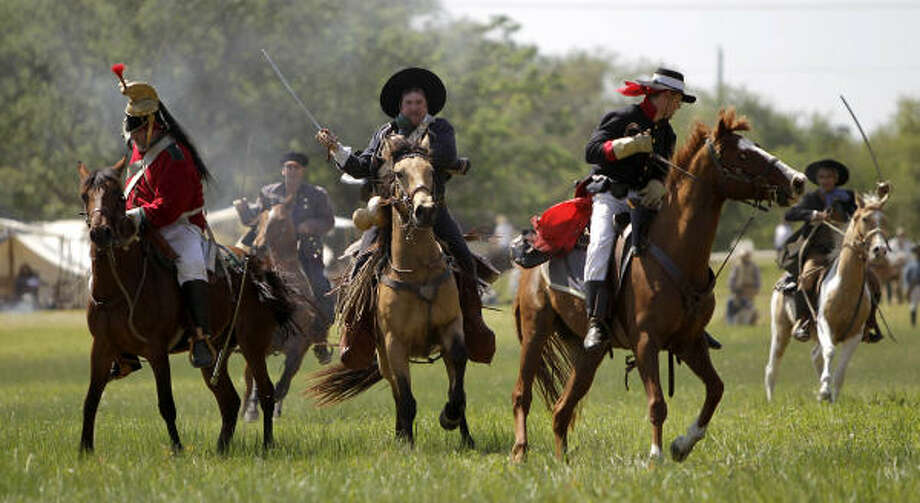 Re-enactors clash on horses simulating events the day before the Battle of San Jacinto on the grounds of the San Jacinto Battleground. Photo: Karen Warren, Houston Chronicle