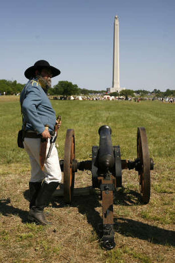 Col. Don Herlitz, playing the part of a US Military advisor to the Texian Army, stands next to a canon on the grounds of the San Jacinto Battleground. Photo: Karen Warren, Houston Chronicle