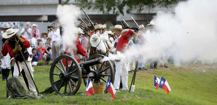 "Members of the Lone Star Volunteers fire ""Rolling Thunder"" during the Lone Star Monument and Historical Flag Park unveiling and dedication in Conroe on the 175th anniversary of the Republic of Texas. Photo: Karen Warren, Houston Chronicle"