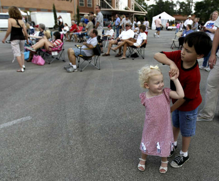 Raymond Kolb, 7, dances with his sister, Caroline Kolb, 2, during the Lone Star Monument and Historical Flag Park unveiling and dedication on the 175th anniversary of the Republic of Texas. Photo: Karen Warren, Houston Chronicle