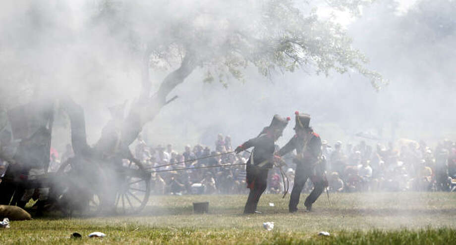 Re-enactors playing the parts o Mexican Army soldiers fire a canon as they simulate events the day before the Battle of San Jacinto. Photo: Karen Warren, Houston Chronicle