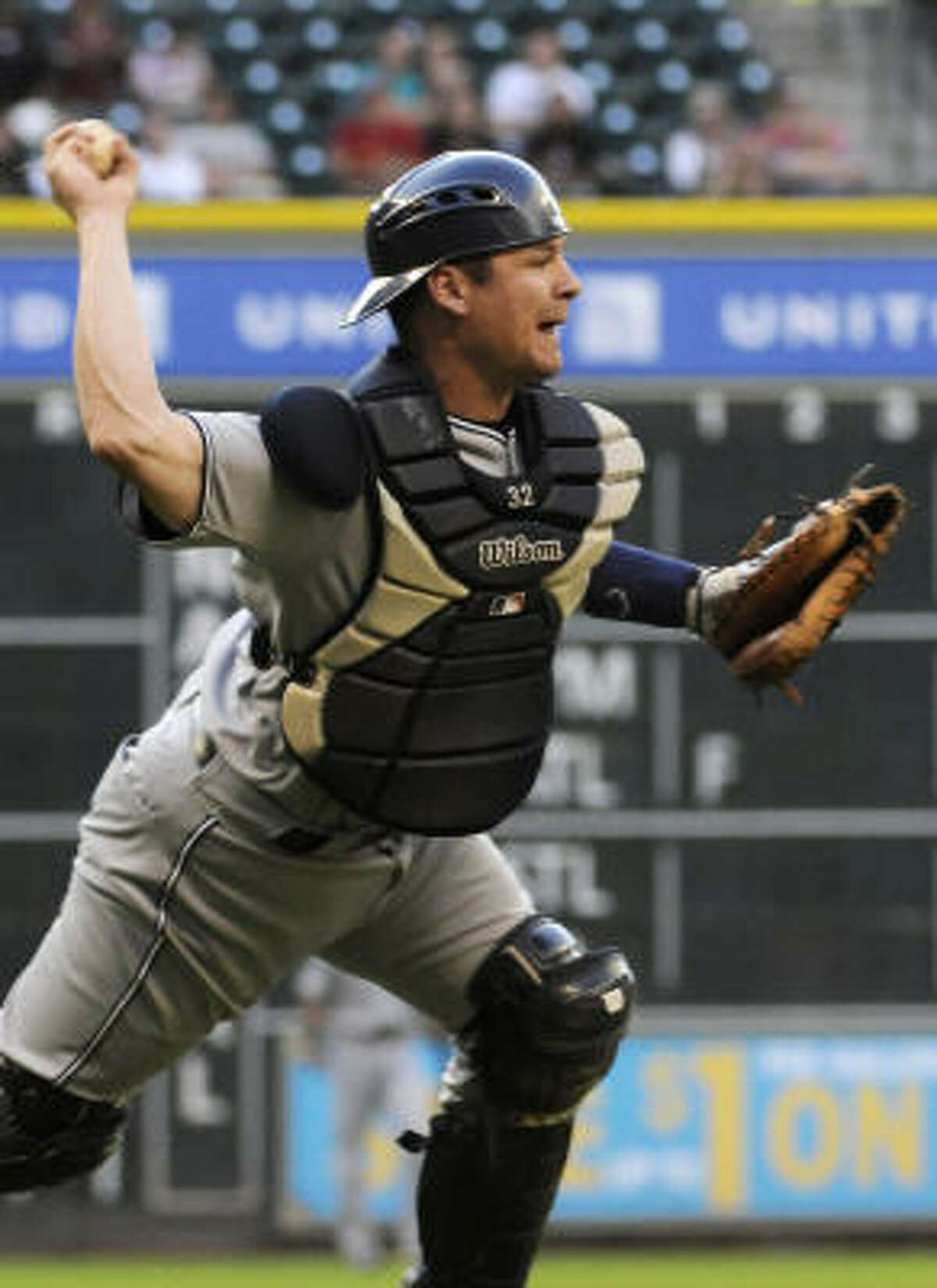 Padres catcher Rob Johnson throws to first base too late to get the out on Astros' Michael Bourn.