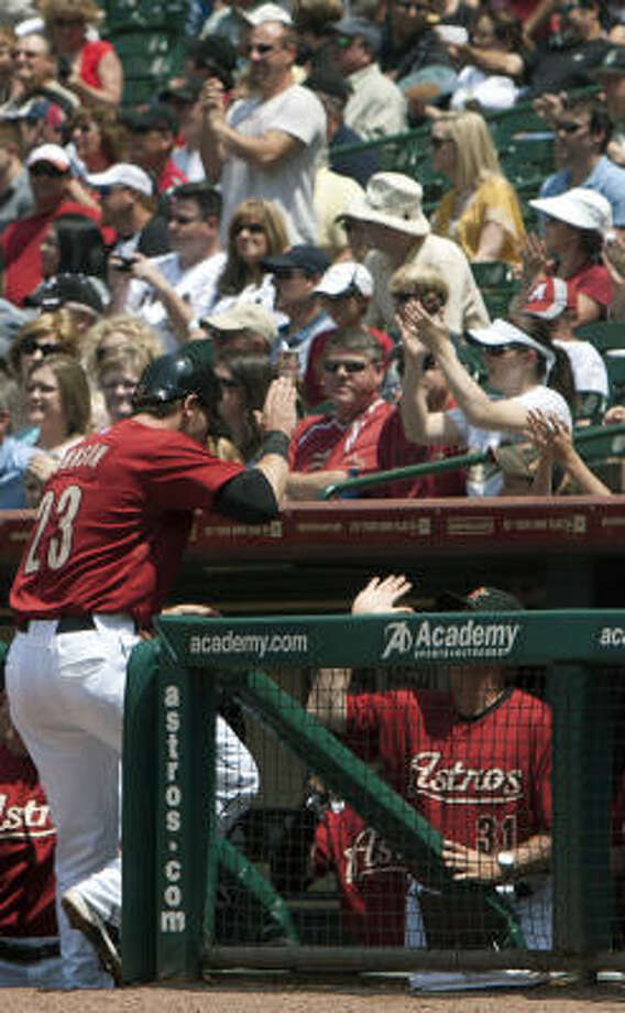 Astros third baseman Chris Johnson returns to the dugout after scoring in the second inning. Photo: Cody Duty, Chronicle