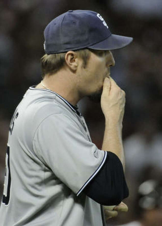 Padres relief pitcher Chad Qualls reacts to loading the bases in the seventh inning. Photo: Pat Sullivan, AP