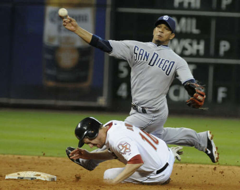 Padres shortstop Alberto Gonzalez, top, trips over Astros' Matt Downs while throwing the ball to first base. Downs was out but Gonzalez was unable to turn the double play. Photo: Pat Sullivan, AP