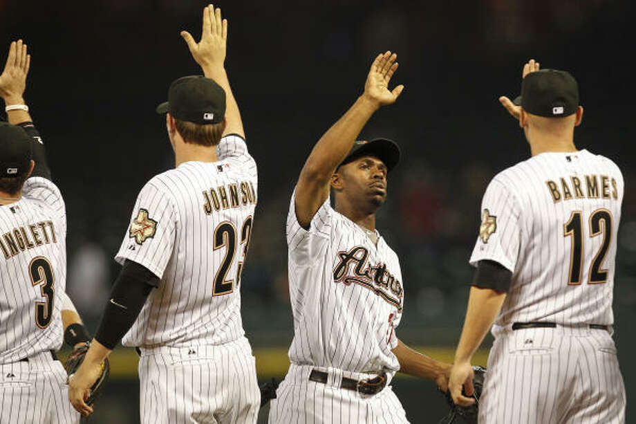 Astros center fielder Michael Bourn, second from right, is congratulated by teammates after recording the game-ending out. Photo: Michael Paulsen, Chronicle