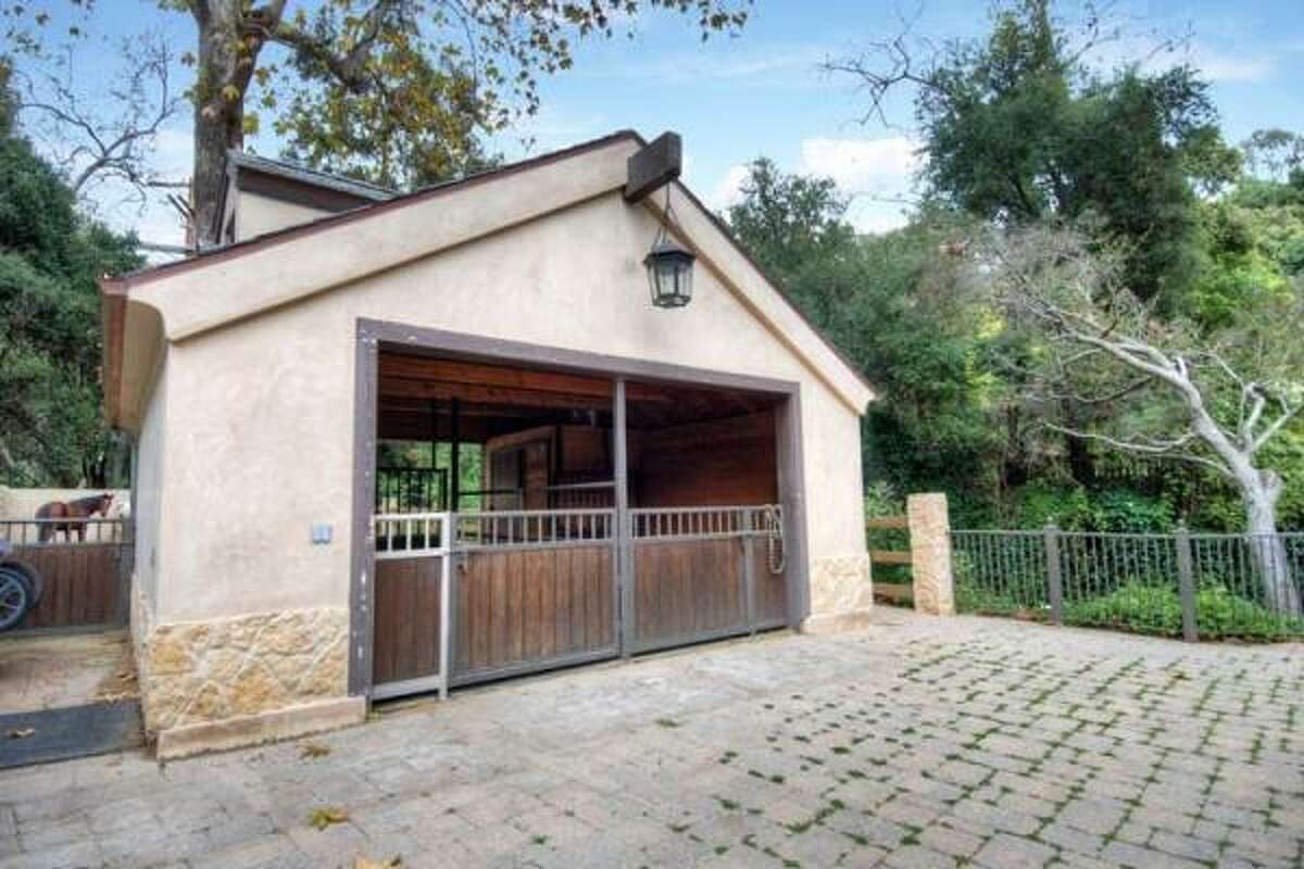 The equestrian estate in Palisades holds a stable and and a corral.
