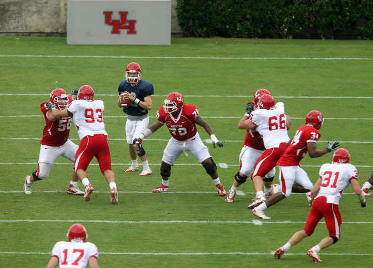 Quarterback Cotton Turner center rear, sets up for a pass during the second quarter of the Red & White spring football game.