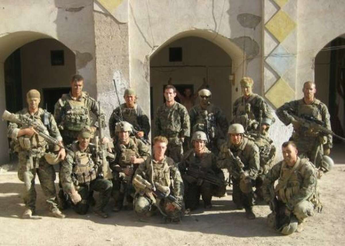 Then-Cpl. Hunt, kneeling at lower right, lost several friends on deployments to Iraq and Afghanistan, where this group photo was taken in 2008. Sgt. Jake Wood, standing second from left, gave the eulogy at Hunt's funeral.