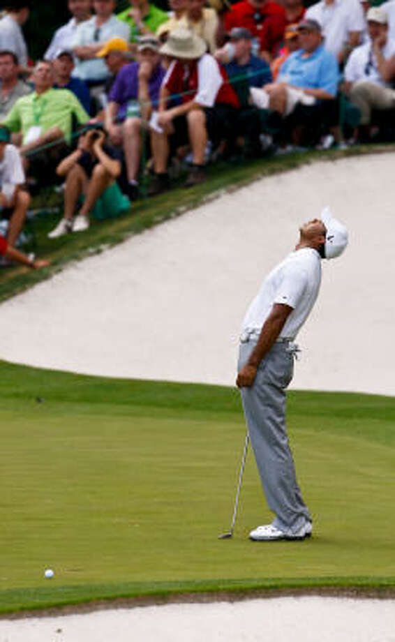 Tiger Woods misses a short birdie putt on the 16th green during the second round. Photo: Tim Dominick, MCT