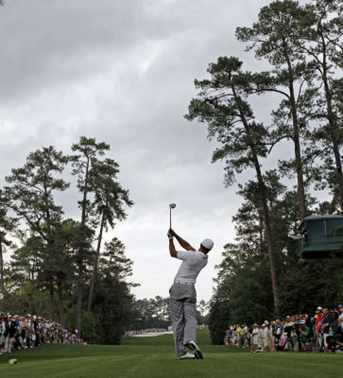 Tiger Woods tees off at the 18th hole during the second round of the Masters golf tournament.