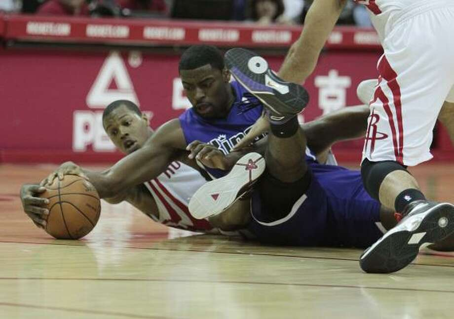 Kyle Lowry  (7) and the Rockets struggled to defeat the Kings on Tuesday night. Photo: Billy Smith II, Chronicle