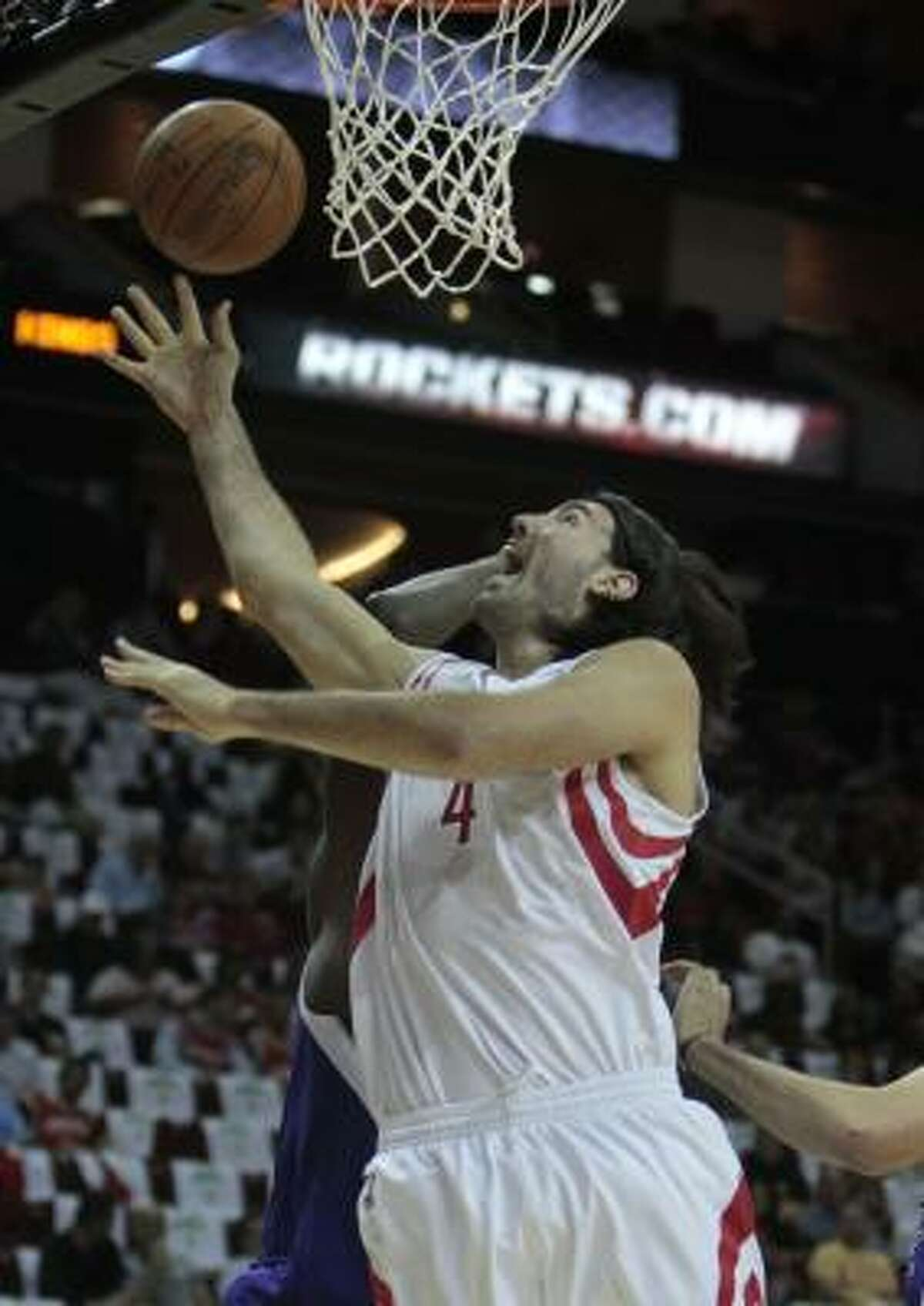 Luis Scola goes hard to the basket.