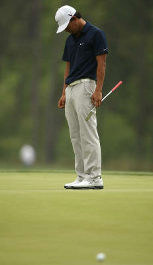 Anthony Kim hangs his head after missing a birdie putt on No. 4. Photo: ERIC CHRISTIAN SMITH, FREELANCE