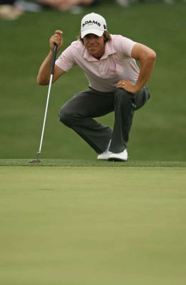 Aaron Baddeley lines up his putt on the No. 18 green during the third round. Photo: ERIC CHRISTIAN SMITH, FREELANCE