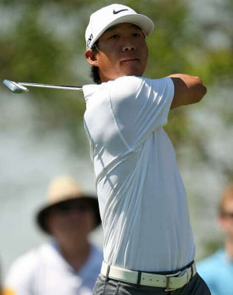 Anthony Kim eyes his tee shot on No. 9 during the second round. Kim finished the day tied for second
