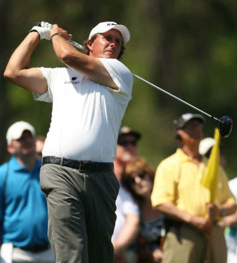 Phil Mickelson follows through on his tee shot on No. 8. Photo: ERIC CHRISTIAN SMITH, For The Chronicle