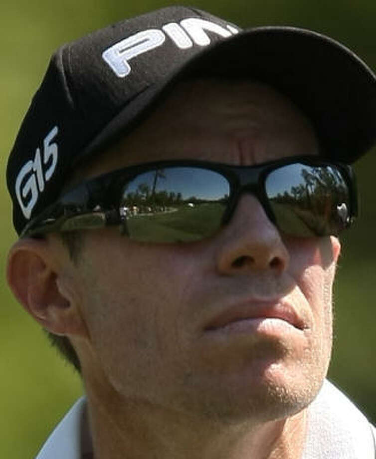 The No. 13 hole is reflected in Nick O' Hern's eyeglasses. Photo: ERIC CHRISTIAN SMITH, For The Chronicle
