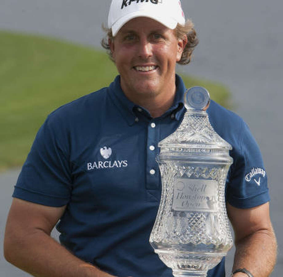 Phil Mickelson holds the trophy after his three-shot victory winning the  Shell Houston Open at Red Stone Golf Club Sunday, April 3, in Humble. Photo: Cody Duty, Houston Chronicle