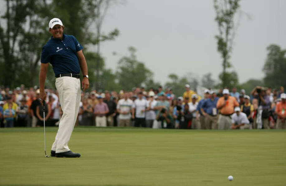 Phil Mickelson reacts after just missing a putt for eagle on No. 15 during the final round of the Sh