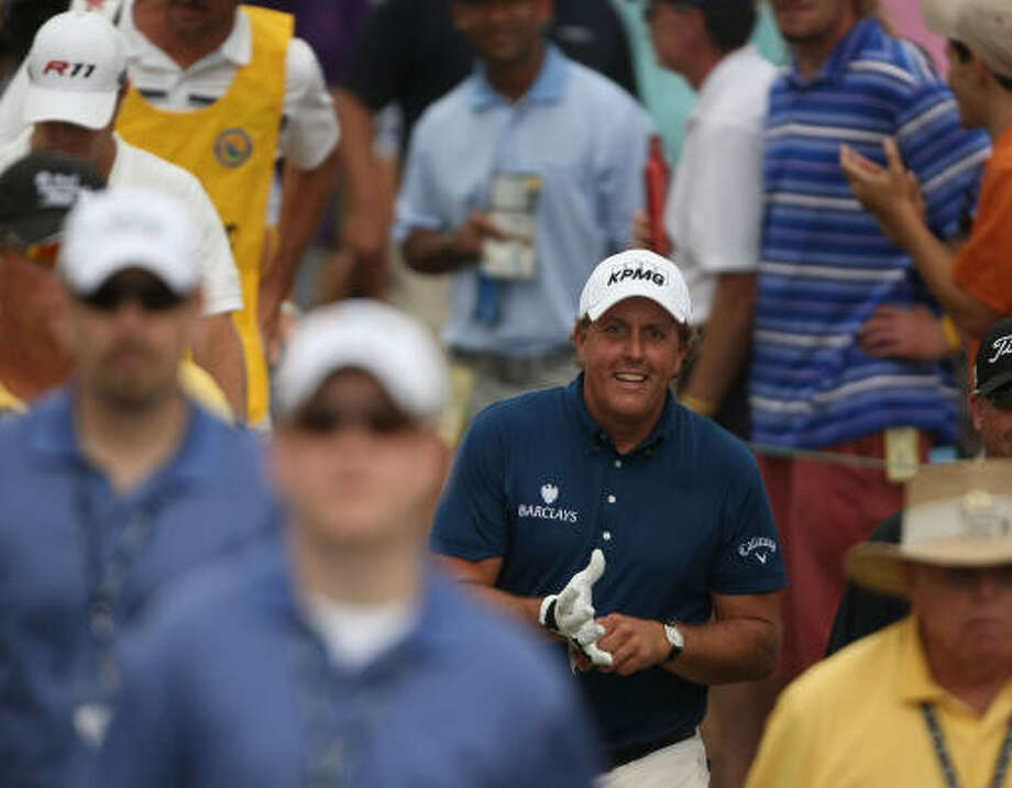 Phil Mickelson makes his way to the No. 11 tee during the final round of the Shell Houston Open. Photo: ERIC CHRISTIAN SMITH, FREELANCE
