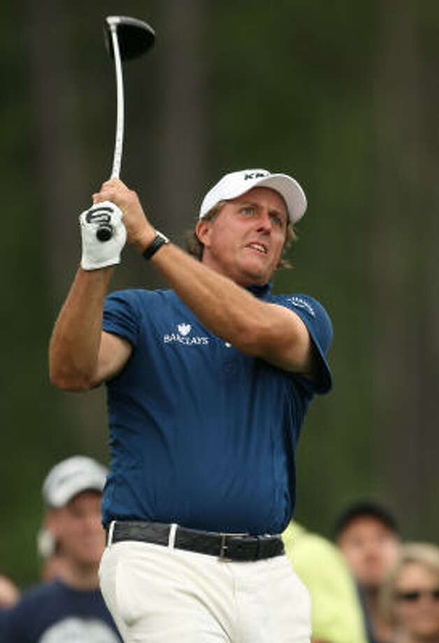 Phil Mickelson eyes his drive on No. 8 during the final round of the Shell Houston Open. Photo: ERIC CHRISTIAN SMITH, FREELANCE