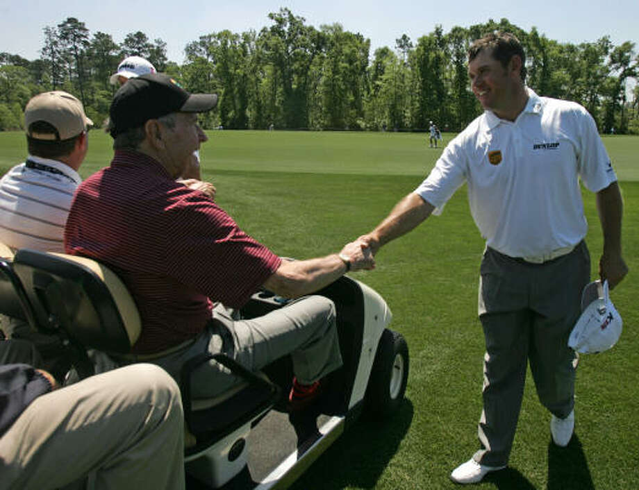 Former President George H. W. Bush, left, greets Lee Westwood on No. 8. Photo: ERIC CHRISTIAN SMITH, For The Chronicle