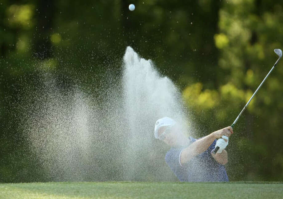 Ben Crane hits out of a greenside bunker on No. 9. Photo: ERIC CHRISTIAN SMITH, For The Chronicle