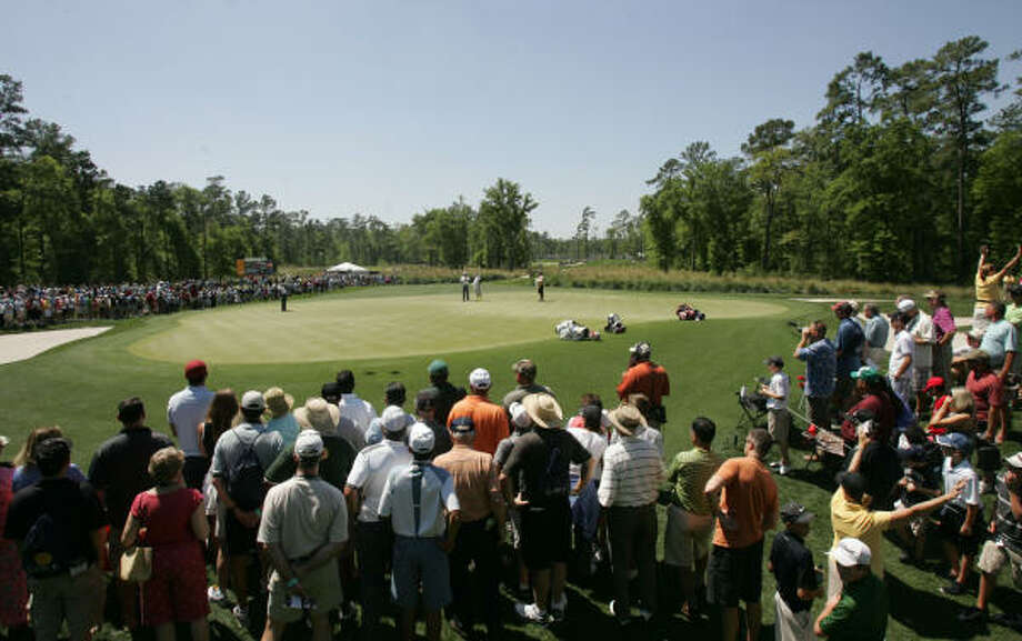 The gallery on No. 9 watches Anthony Kim save his par putt during the second round. Photo: ERIC CHRISTIAN SMITH, For The Chronicle