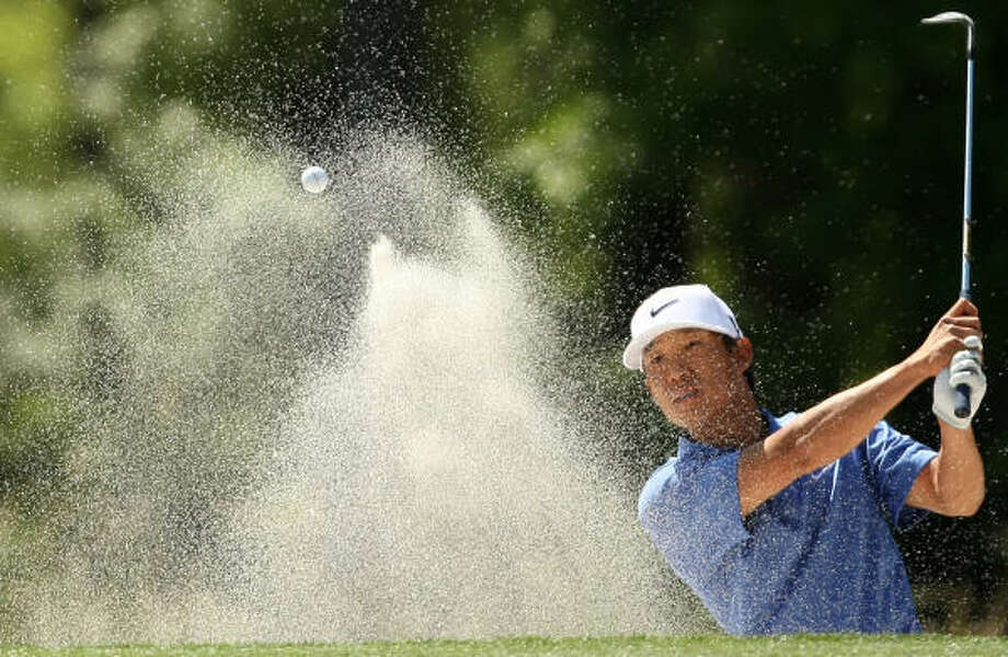Defending champion Anthony Kim blasts from a greenside bunker on No. 9. Photo: ERIC CHRISTIAN SMITH, For The Chronicle