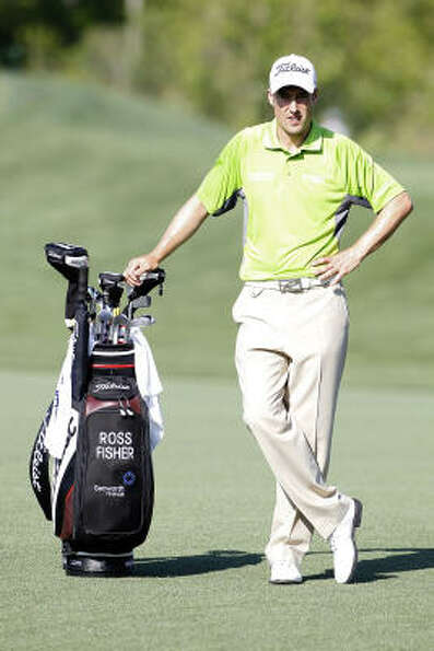 Ross Fisher of England stands by his golf bag during the first round of the Shell Houston Open at Re