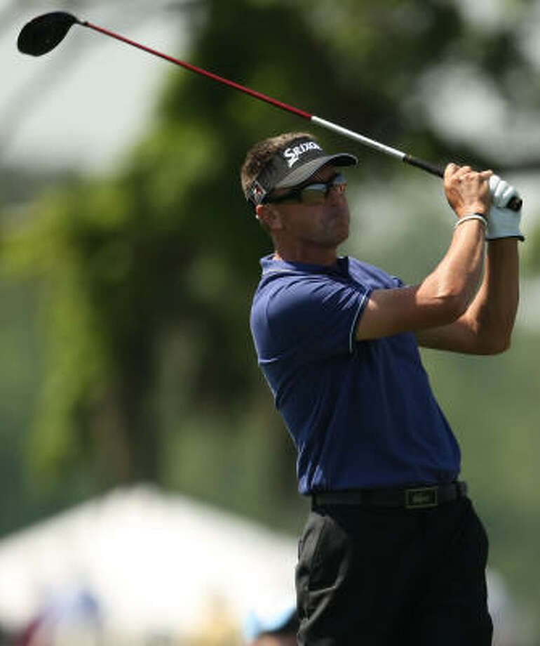Robert Allenby eyes his tee shot on No. 18. Allenby was good for a 4-under-par 68. Photo: ERIC CHRISTIAN SMITH, For The Chronicle