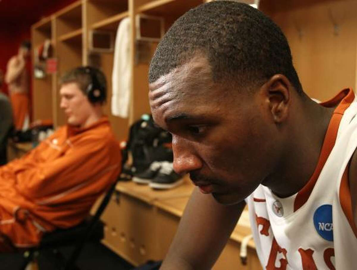 Texas guard/forward Jordan Hamilton (3) sits for a moment before he's interviewed by the media after losing to the Arizona.
