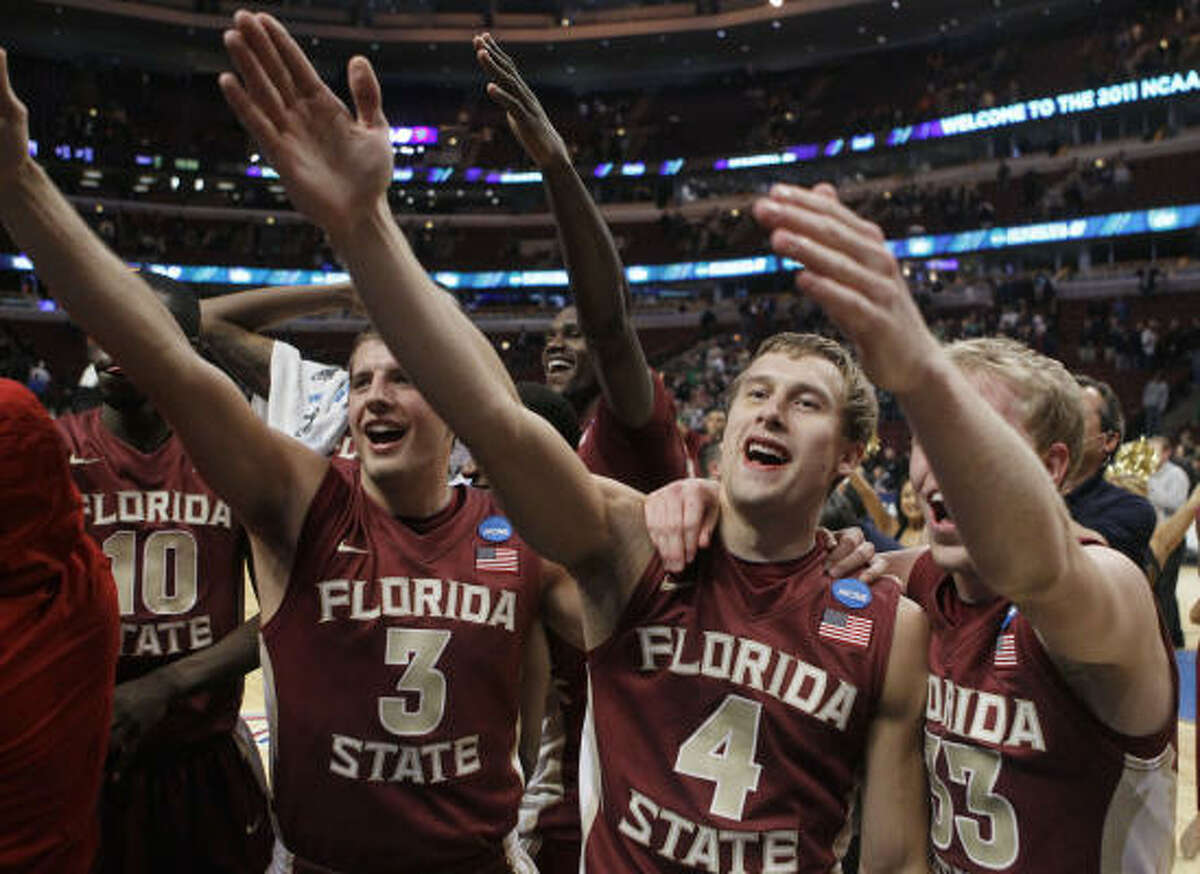 No. 10 Florida State 71, No. 2 Notre Dame 57 Florida State's Luke Loucks (3), Deividas Dulkys (4) and Joey Moreau (33) perform the tomahawk chop as they celebrate the team's victory.