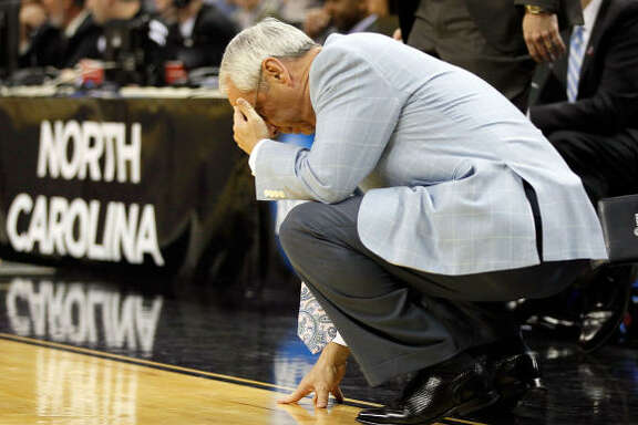 North Carolina head coach Roy Williams hangs his head in reaction to a first-half play.