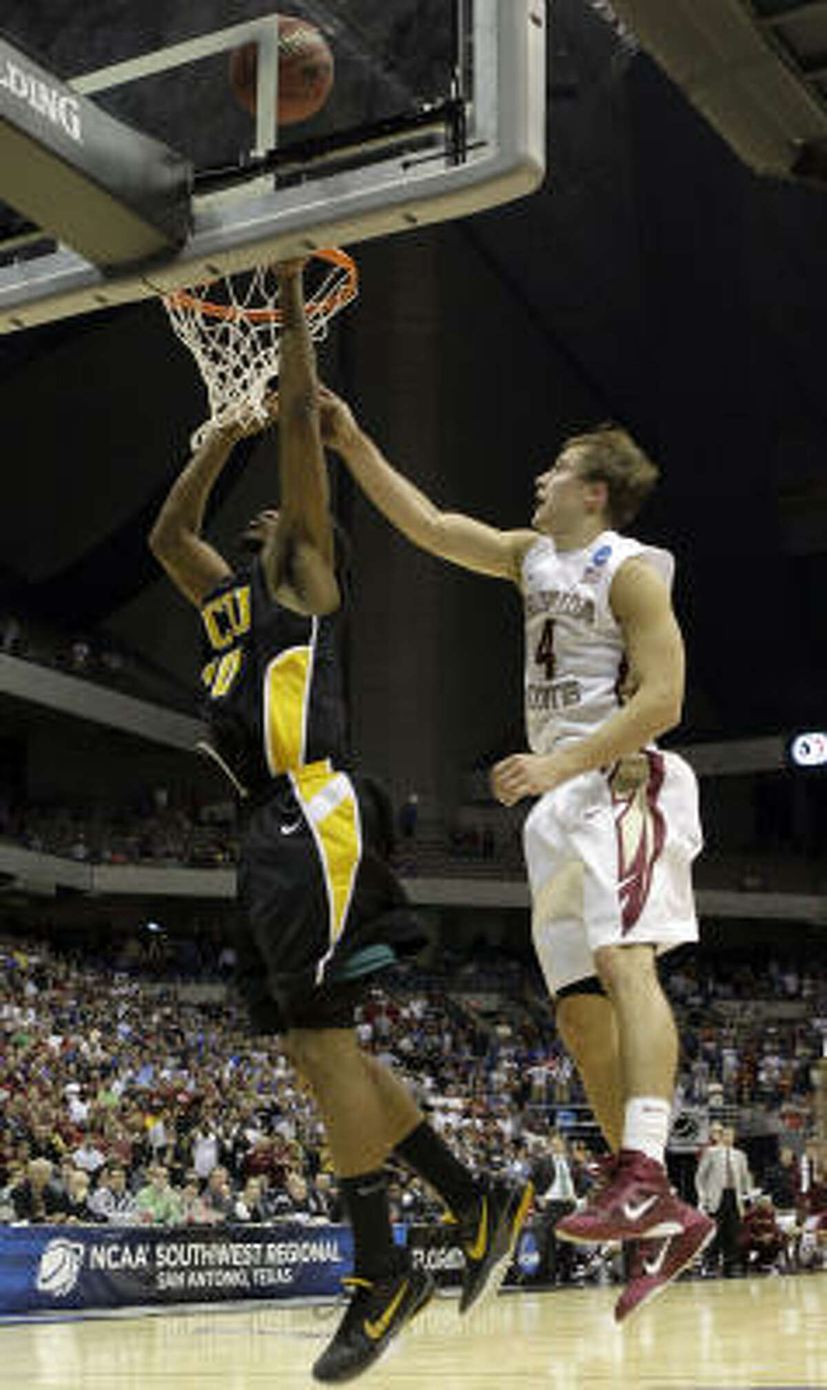 Virginia Commonwealth's Bradford Burgess makes the winning shot as Florida State's Deividas Dulkys defends during the overtime at a Southwest regional semifinal game. VCU won 72-71. The 11th-seeded Rams are advancing to their first Elite Eight.