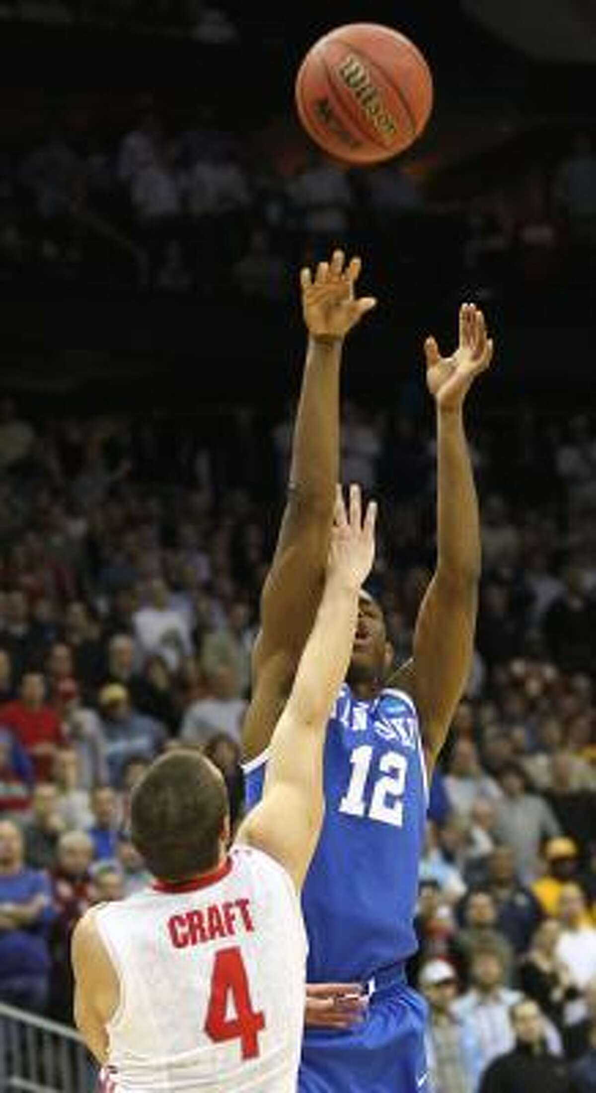 Kentucky guard Brandon Knight (12) scores the game-winning basket over Ohio State guard Aaron Craft in the closing seconds of Friday's game.
