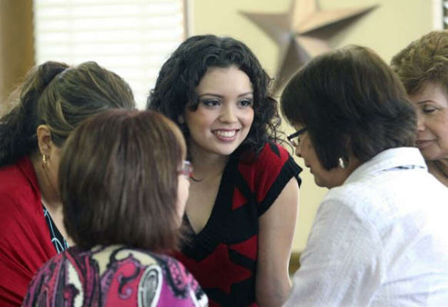 Ousted Miss San Antonio Domonique Ramirez chats with her supporters at the Bexar County Courthouse. She's suing in a bid to reclaim her crown and sash. Photo: Tom Reel, San Antonio Express-News