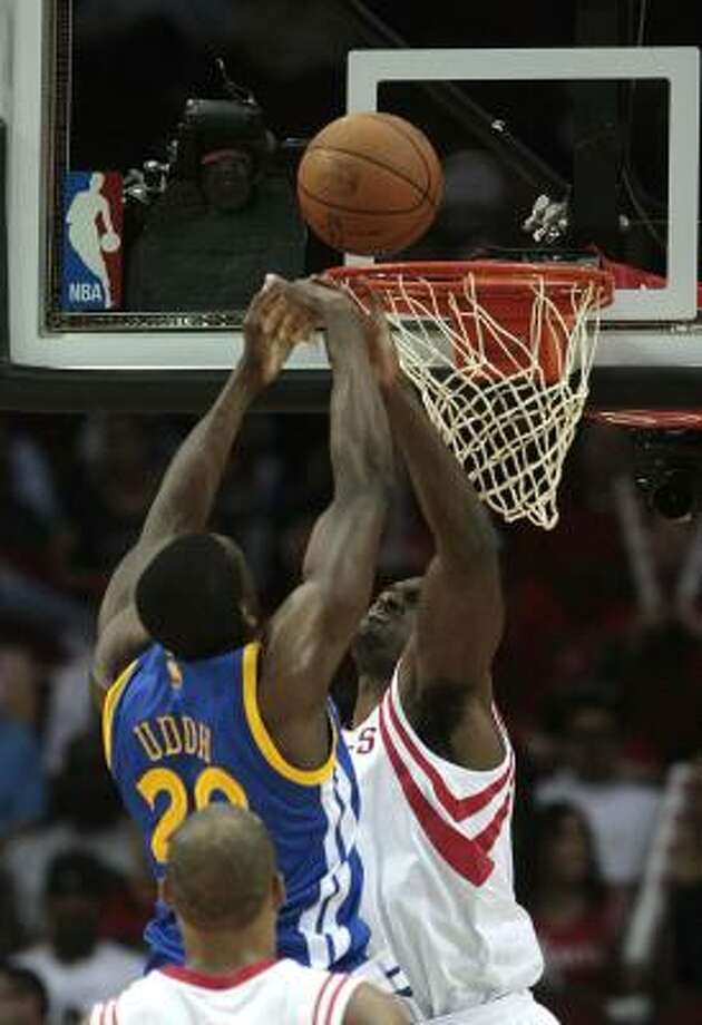 Warriors center Ekpe Udoh (20) gets his shot blocked by Rockets forward Patrick Patterson. Photo: Billy Smith II, Chronicle