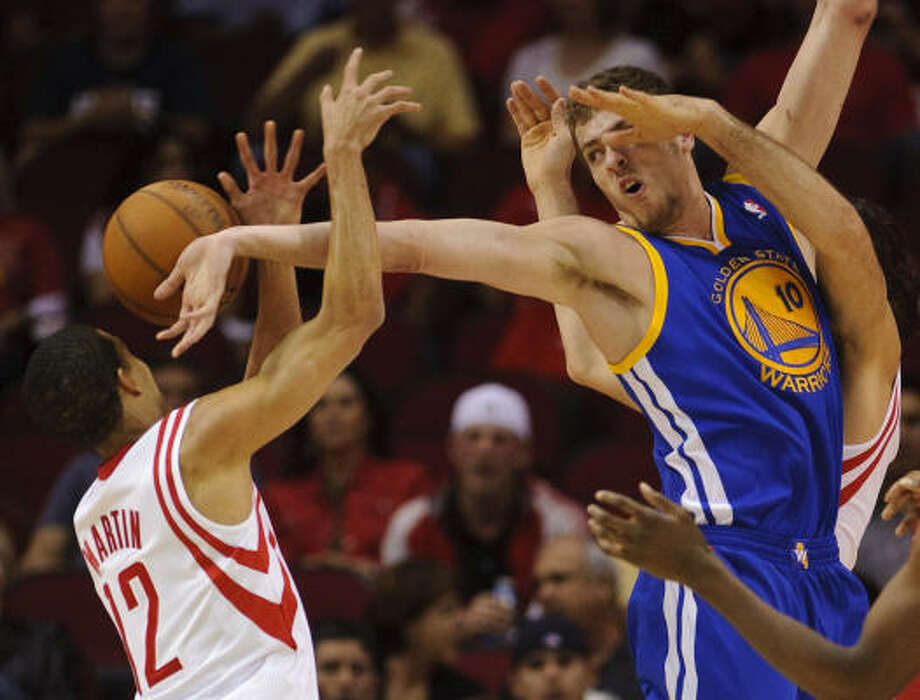 Warriors' David Lee, right, tries to get a rebound as Rockets shooting guard Kevin Martin (12) defends. Photo: Dave Einsel, AP