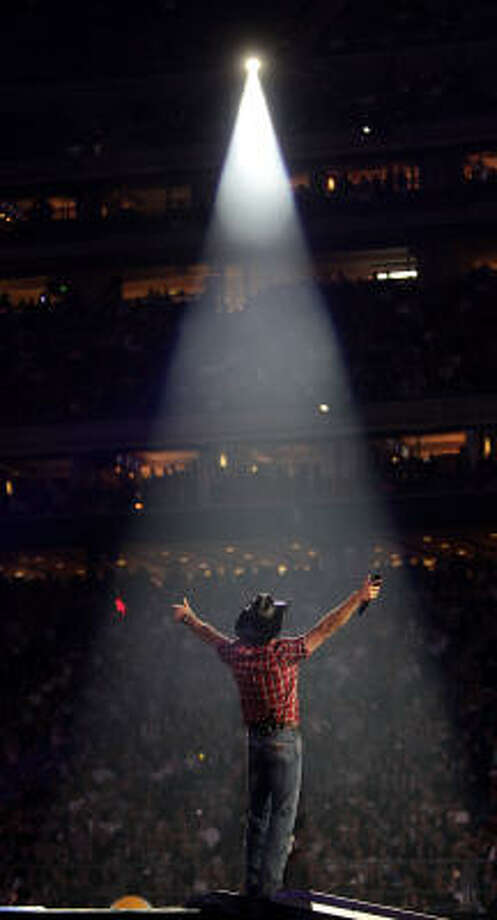 Tim McGraw raises his arms to the crowd as he performs during the Houston Livestock Show and Rodeo. Photo: Karen Warren, Houston Chronicle