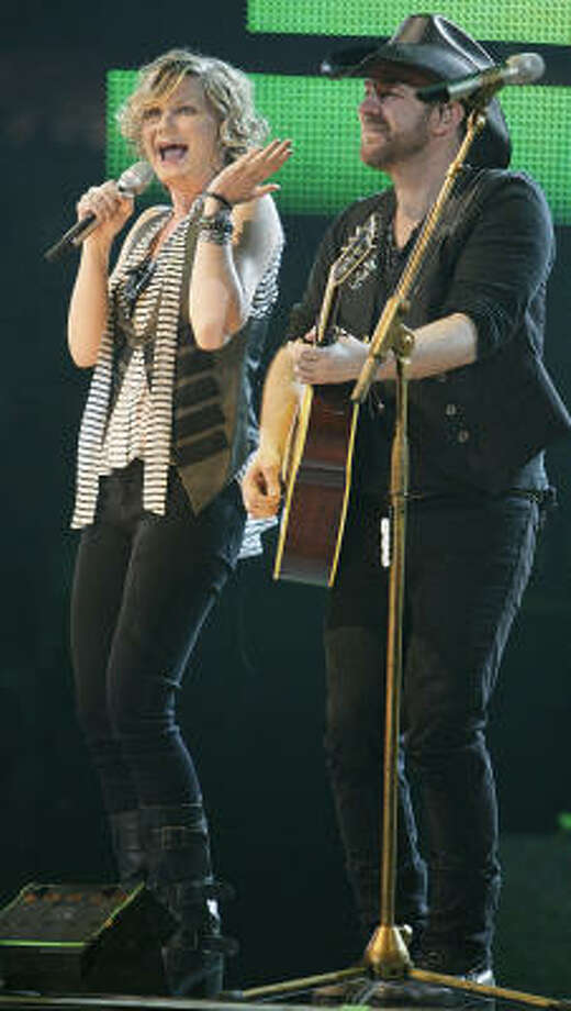 Sugarland's Jennifer Nettles left, and Kristian Bush during the band's performance at the Houston Livestock Show and Rodeo at Reliant Stadium Thursday, March 3, 2011, in Houston. Photo: James Nielsen, Houston Chronicle
