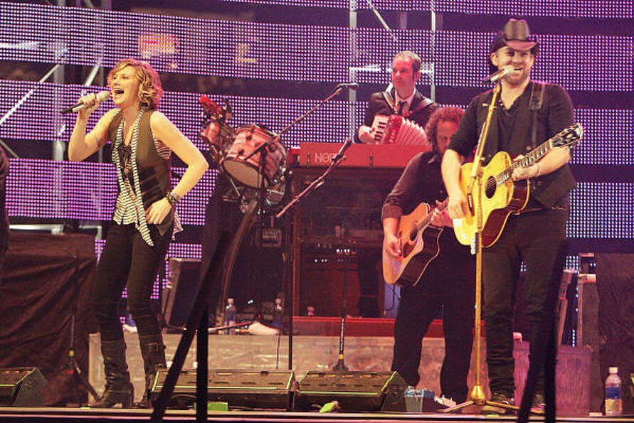 Sugarland's Jennifer Nettles left, and Kristian Bush during the band's performance at the Houston Li