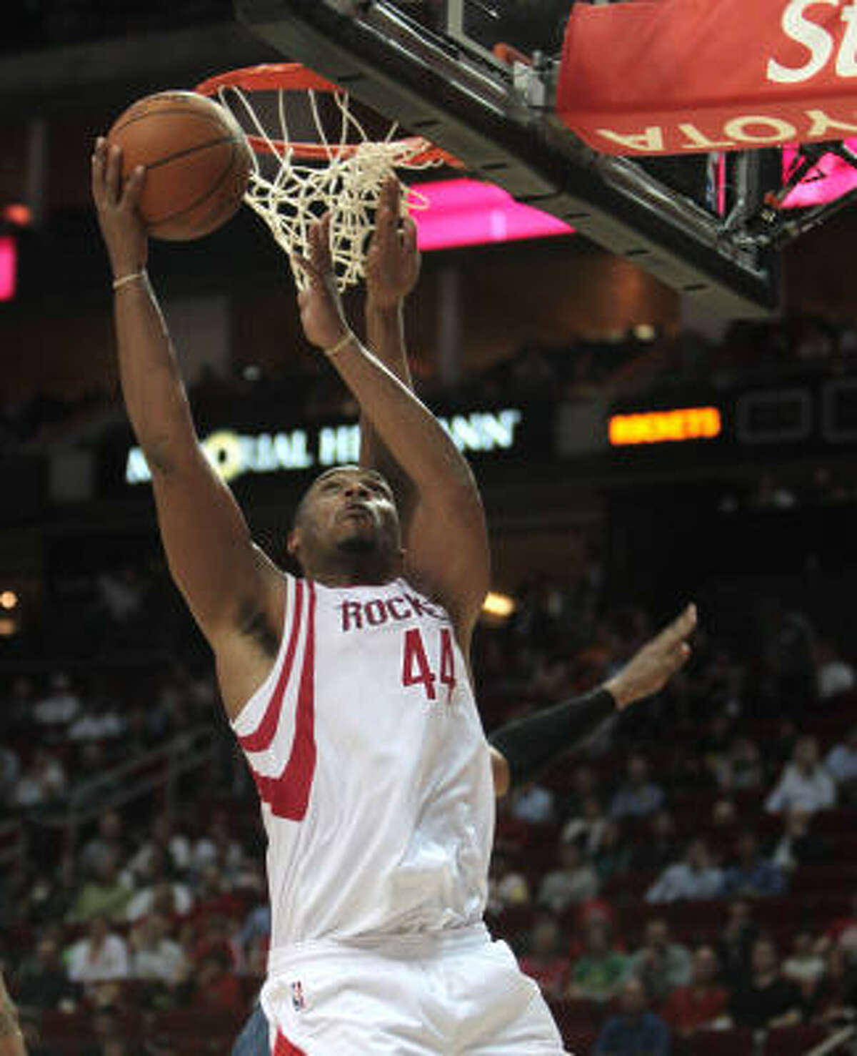 Rockets center Chuck Hayes gets a layup in the fourth quarter. Hayes had a monstrous game, finished with nine points, 17 rebounds, seven assists and three steals.